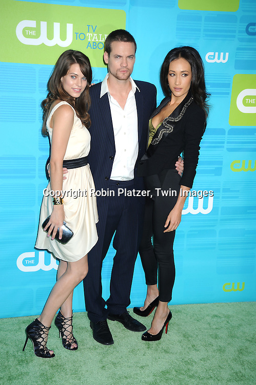 "Lyndsy Fonseca, Shane West and Maggie Q of "" Nikita""  posing for photographers at the CW Network 2010 Upfront on May 20, 2010 at Madison Square Garden in New York City."