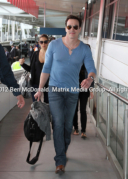 7/3/2012. Sydney, Australia...NON EXCLUSIVE..American Pie - The reunion cast including Mena Suvari, Chris Klein and Jason Scott-Patrick at airport enroute to Melbourne on the publicity trail.