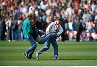Two fans rush to carry an injured fan to safety, The Hillsborough Disaster, Liverpool v Notts Forest, FA Cup Semi-Final, 890415. Mike Hewitt/Action Plus...1989.soccer.football.tragedy.crowd.crowds.supporters.fans.spectators
