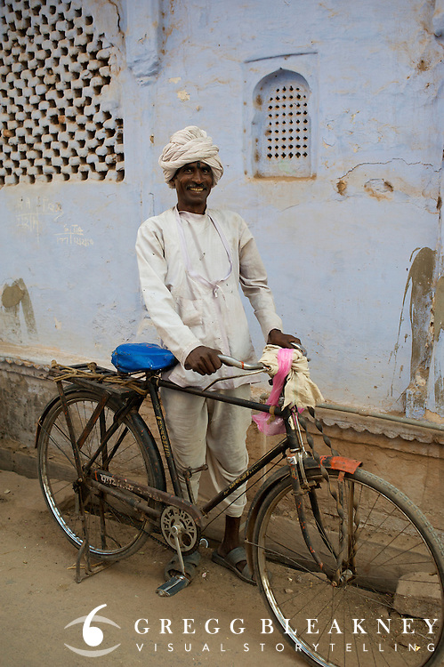 A day laborer commutes to his village via bicycle - Rajasthan, India