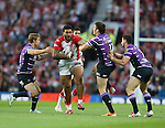 St Helens Mose Masoe is tackled- First Utility Super League Grand Final - St Helens v Wigan Warriors - Old Trafford Stadium - Manchester - England - 11th October 2014 - Pic Paul Currie/Sportimage