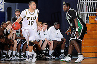 6 February 2010:  FIU's J.C. Otero (10) is defended by North Texas' Eric Tramiel (25) in the first half as the North Texas Mean Green defeated the FIU Golden Panthers, 68-66, at the U.S. Century Bank Arena in Miami, Florida.