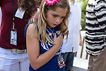 Madison Wilson, age 9, holds her hand to her heart during the playing of God Bless America before a campaign rally with Republican Vice Presidential candidate Paul Ryan (R-WI) on Saturday, August 18, 2012 in The Villages, FL.