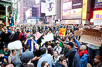 "Protesters with ""Occupy Wall Street"" occupy a large swath of Times Square on October 15, 2011 in New York City.  While crowd estimates numbered in the tens of thousands, police tactics (including nets, motor scooters, barricades, arrests, and intimidation by riders on horseback) prevented the crowd, which had been split up, from joining together as one in the middle of Times Square."