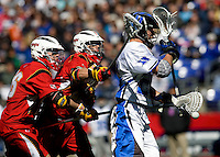 Robert Rotanz (26) of Duke has the ball taken away from him by a Maryland defender during the Face-Off Classic in at M&T Stadium in Baltimore, MD