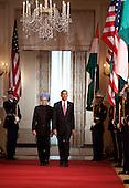Washington, DC - November 24, 2009 -- Manmohan Singh, left, India's prime minister, and U.S. President Barack Obama walk during an arrival ceremony at the White House in Washington, D.C., U.S., on Tuesday, November 24, 2009.  .Credit: Joshua Roberts - Pool via CNP