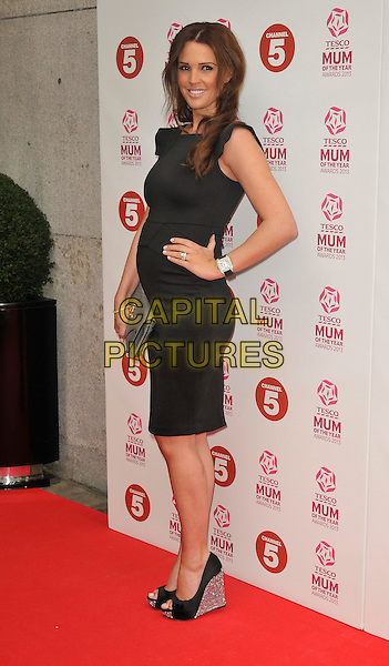 Danielle O'Hara (nee Lloyd).attended the Tesco Mum Of The Year Awards 2013, Savoy Hotel, The Strand, London, England..March 3rd, 2013.full length dress pregnant clutch bag grey gray hand on hip black side silver wedges shoes .CAP/WIZ.© Wizard/Capital Pictures.