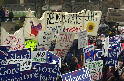 Washington, DC - January 20, 2001 -- Anti-Bush protesters line Pennsylvania Avenue during the Inaugural parade in honor of President George W. Bush. .Credit: Ron Sachs / CNP