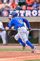 Kingsport Mets catcher Dionis Rodriguez (11) runs to first during a game against the Greeneville Astros at Pioneer Park on July 3, 2016 in Greeneville, Tennessee. The Mets defeated the Astros 11-0. (Tony Farlow/Four Seam Images)