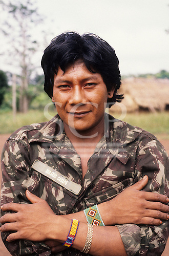 A-Ukre, Brazil. Kayapo Indian wearing his Brazilian army fatigues with colourful bead bracelets. Horacio Cayapo.