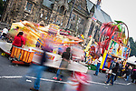 © Joel Goodman - 07973 332324 . 31 August 2013 . Rochdale , UK . Slow shutter speed photo of colourful whirlygig funfair things in front of the town hall . The Rochdale Feel Good Festival . Photo credit : Joel Goodman