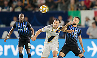 CARSON, CA - SEPTEMBER 21: Zlatan Ibrahimovic #9 of the Los Angeles Galaxy and Rudy Camacho #4 of the Montreal Impact battle for a ball during a game between Montreal Impact and Los Angeles Galaxy at Dignity Health Sports Park on September 21, 2019 in Carson, California.