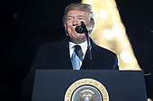 United States President Donald J. Trump speaks during the 97th annual National Christmas Tree Lighting ceremony at the Ellipse in President's Park near the White House in Washington, DC on December 5, 2019.<br /> Credit: Oliver Contreras / Pool via CNP