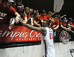 "Mississippi's Reginald Buckner (23) celebrates with fans following a win over Tennessee at the C.M. ""Tad"" Smith Coliseum on Thursday, January 24, 2013. Mississippi won 62-56 to improve to 5-0 in the SEC. (AP Photo/Oxford Eagle, Bruce Newman)"