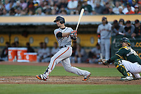 OAKLAND, CA - AUGUST 1:  Buster Posey #28 of the San Francisco Giants bats against the Oakland Athletics during the game at the Oakland Coliseum on Tuesday, August 1, 2017 in Oakland, California. (Photo by Brad Mangin)