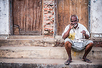 Negombo, Portrait of a man smoking a cigar on the streets of Negombo on the West Coast of Sri Lanka, Asia. This is a portrait of a man smoking a cigar on the streets of Negombo on the West Coast of Sri Lanka, Asia.