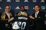 14 January 2010: Danny Mwanga (center) was selected with the #1 overall pick by the Philadelphia Union. From left: Tom Veit, Danny Mwanga, Nick Sakiewicz. The 2010 MLS SuperDraft was held in the Ballroom at Pennsylvania Convention Center in Philadelphia, PA during the NSCAA Annual Convention.