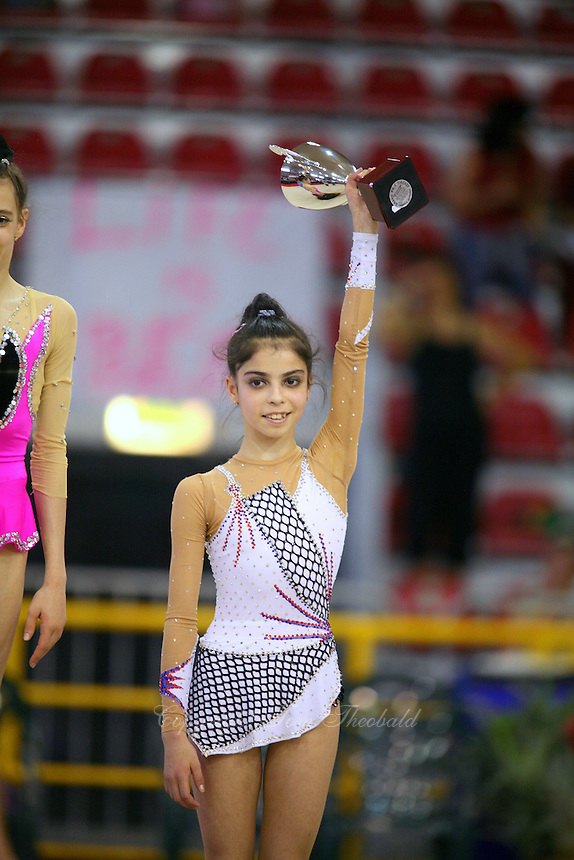 Filipa Siderova of Bulgaria celebrates winning bronze in junior All-Around at 2006 Trofeo Cariprato in Prato, Italy on June 17, 2006.  (Photo by Tom Theobald)