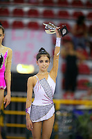 Filipa Siderova of Bulgaria celebrates winning bronze in junior All-Around at 2006 Trofeo Cariprato in Prato, Italy on June 17, 2006.  (Photo by Tom Theobald)