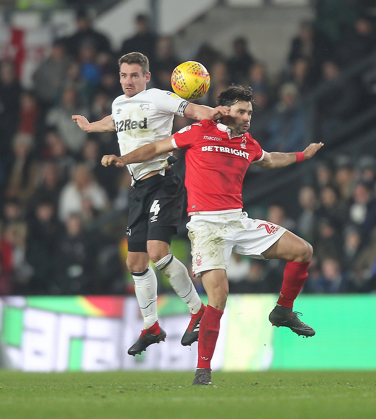 Derby County's Craig Bryson jumps with Nottingham Forest's Claudio Yacob<br /> <br /> Photographer Mick Walker/CameraSport<br /> <br /> The EFL Sky Bet Championship - Derby County v Nottingham Forest - Monday 17th December 2018 - Pride Park - Derby<br /> <br /> World Copyright © 2018 CameraSport. All rights reserved. 43 Linden Ave. Countesthorpe. Leicester. England. LE8 5PG - Tel: +44 (0) 116 277 4147 - admin@camerasport.com - www.camerasport.com