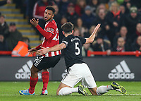 24th November 2019; Bramall Lane, Sheffield, Yorkshire, England; English Premier League Football, Sheffield United versus Manchester United; Lys Mousset of Sheffield United  appeals for a foul as he is challenged by Harry Maguire of Manchester United  - Strictly Editorial Use Only. No use with unauthorized audio, video, data, fixture lists, club/league logos or 'live' services. Online in-match use limited to 120 images, no video emulation. No use in betting, games or single club/league/player publications
