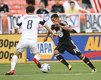Andy Najar #14 of D.C. United cuts past Will Johnson #8 of Real Salt Lake during an MLS match at RFK Stadium, on June 5 2010 in Washington DC. The game ended in a 0-0 tie.