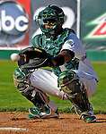 2 July 2011: Vermont Lake Monsters' catcher Diomedes Lopez warms up his starting pitcher prior to a game against the Tri-City ValleyCats at Centennial Field in Burlington, Vermont. The Lake Monsters rallied from a 4-2 deficit to defeat the ValletCats 7-4 in NY Penn League action. Mandatory Credit: Ed Wolfstein Photo
