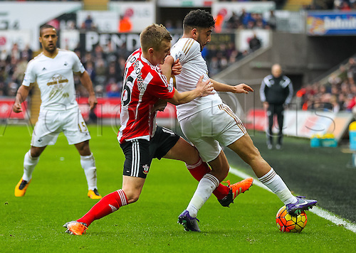 13.02.2016. Liberty Stadium, Swansea, Wales. Barclays Premier League. Swansea versus Southampton. Southampton's James Ward-Prowse battles to get the ball from Swansea City's Neil Taylor