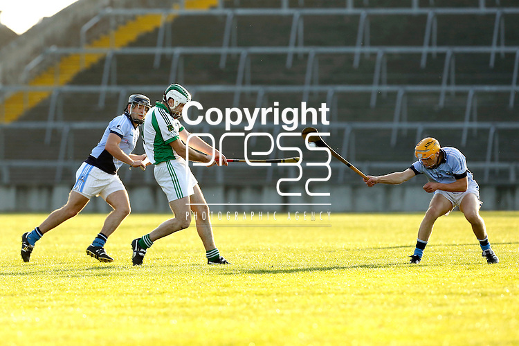 13/09/2014<br /> Adrian Breen of Na Piarsaigh blocks down a shot from Ian Burke of Ballybrown in the Round 5 of the Limerick Senior Hurling Championship match which took place at the Gaelic Grounds, Limerick.<br /> Pic: Don Moloney/Press 22