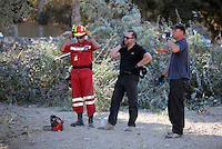 FAO JANET TOMLINSON, DAILY MAIL PICTURE DESK<br /> Pictured: Special forensics police officers and a Red Cross worker take a small break before felling a tree after to make space for a further search by a disused building in a field in Kos, Greece. Saturday 01 October 2016<br /> Re: Police teams led by South Yorkshire Police, searching for missing toddler Ben Needham on the Greek island of Kos have moved to a new area in the field they are searching.<br /> Ben, from Sheffield, was 21 months old when he disappeared on 24 July 1991 during a family holiday.<br /> Digging has begun at a new site after a fresh line of inquiry suggested he could have been crushed by a digger.