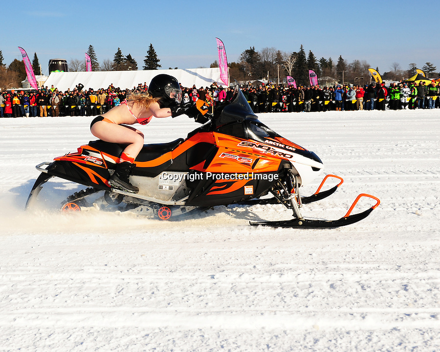 Hundreds of snowmobilers and other spectators attend the 2013 Cruiserfest, presented by the Cross Country Cruisers snowmobile club. The event was held Saturday, Feb. 9 on Lake Minocqua, Minocqua, WI. The event featured radar runs, bikini runs, antique and classic snowmobile display, and vendors.