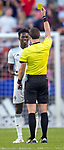 Colorado Rapids forward Dominique Badji (14) receives a yellow card from the referee in the first half Saturday, April 21, 2018, during the Major League Soccer game at Rio Tiinto Stadium in Sandy, Utah. RSL beat the Colorado Rapids 3-0. (© 2018 Douglas C. Pizac)
