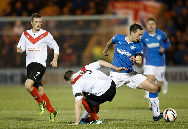 Lee Wallace jinks past Mick O'Byrne