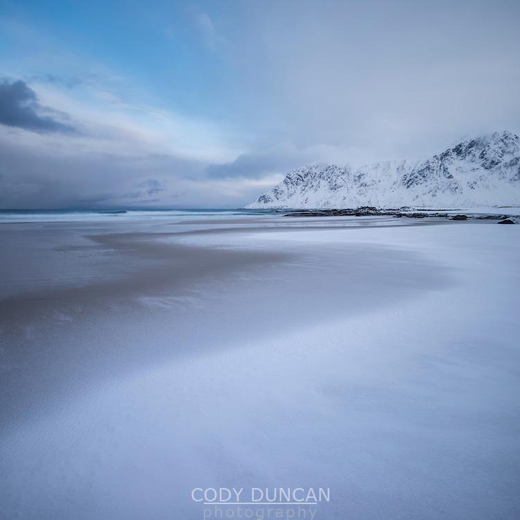 Snow covered Skagsanden beach, Flakstadøy, Lofoten Islands, Norway