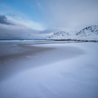 Snow covered Skagsanden beach, Flakstadøy, Lofoten Islands, Norway
