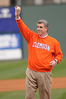 Athletics director Dan Radakovich of the Clemson Tigers throws out the first pitch prior to a game against the South Carolina Gamecocks on Saturday, March 2, 2013, at Fluor Field at the West End in Greenville, South Carolina. Clemson won the Reedy River Rivalry game 6-3. (Tom Priddy/Four Seam Images)