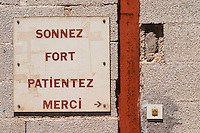 Sonnez Fort - Sing the bell hard. Patientez - wait. Merci - Thank you. Door bell. Domaine Ermitage du Pic St Loup, Chateau Ste Agnes. Pic St Loup. Languedoc. France. Europe.