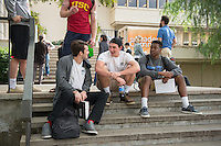 Occidental College students sit on the steps leading up to the Academic Commons, Mary Norton Clapp Library, Jan. 27, 2016. <br /> (Photo by Marc Campos, Occidental College Photographer)