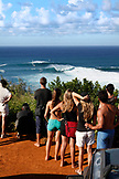 USA, Hawaii, Maui, spectators watch windsurfers on large waves at a break called Jaws or Peahi
