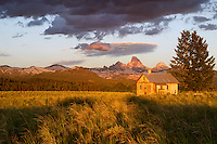 Idaho Homestead.  Last evening I ventured out from our cabin in Island Park, Idaho with the intent of photographing along the Henry's Fork of The Snake River.  Forty minutes later I found myself  - once again - staring at the Teton range, this time from the Idaho side near a classic rural homestead.  This beautifully weathered historic home  sits on private property under a conservation easement held by the Teton Regional Land Trust which helps landowners preserve their property in perpetuity.  The concept of conservation easements is vitally important in this area as development interests have dramatically changed so much of the historic ranching and farming landscape in and around the Teton Valley.  Kudos to my friend Connie for having the vision and foresight to protect this beautiful land, and I am grateful for the Land Trust organizations of the west for their efforts to save such land and landscapes for future generations.  June 29, 2014