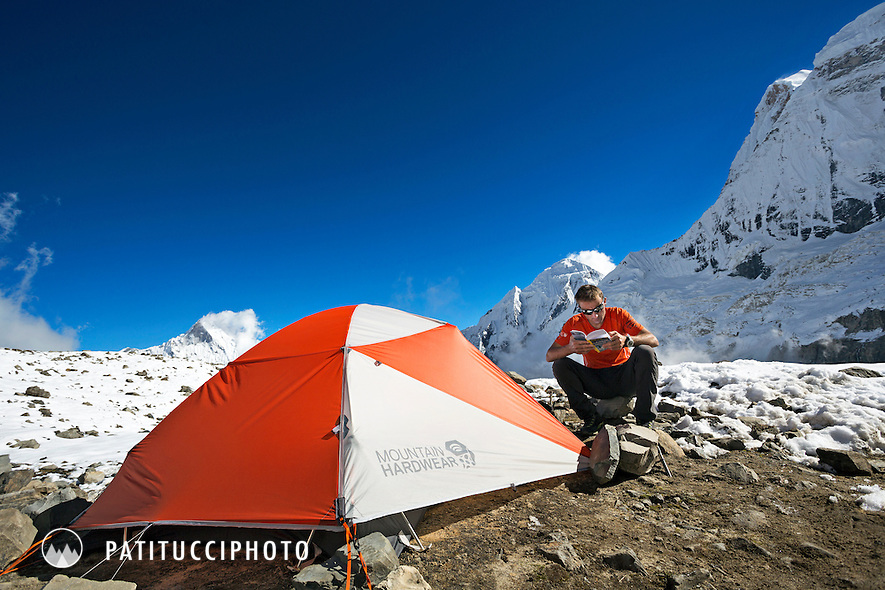 Ueli Steck returned to Nepal and the Annapurna south face in 2013 which he climbed solo, without oxygen, in one 28 hour alpine push, via a new route. The trip was his third attempt to climb the 8000 meter peak. Ueli reading a book outside his tent in advance basecamp.