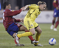 08 November 2006: CSD Municipal's Sergio Guevara, left, trips Columbus Crew's Danny Szetela during the second half in Columbus, Ohio.<br />