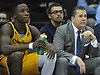 Tom Pecora, Associate Head Coach for Quinnipiac University Men's Basketball, right, sits alongside Abdulai Bundu #34 as they observe the action on the court during an MAAC game against Fairfield University at Nassau Coliseum on Saturday, Jan. 27, 2018.