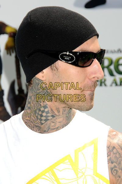 """TRAVIS BARKER .Attending the """"Shrek Forever After"""" Los Angeles Film Premiere held at the Gibson Amphitheatre, Universal City, California, USA, 16th May 2010..arrivals portrait headshot tattoo profile side  white tattoos hat sunglasses black beanie.CAP/ADM/BP.©Byron Purvis/AdMedia/Capital Pictures."""