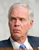 """United States Senator Ron Johnson (Republican of Wisconsin), a member of the U.S. Senate Foreign Relations Committee, listens to testimony during the hearing on """"Authorization of Use of Force in Syria"""" on Capitol Hill in Washington, D.C. on Tuesday, September 3, 2013.<br /> Credit: Ron Sachs / CNP"""