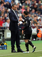 (L-R) Swansea manager Paul Clement thanks Leon Britton as ce comes off the pitch during the Premier League match between West Ham United v Swansea City at the London Stadium, London, England, UK. Saturday 30 September 2017