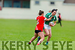 Meabh Barry been tackled by Emily O'Riardon of Rathmore in the Randles Bros Kerry LGFA Senior Football Championship.