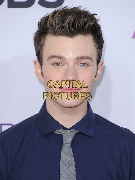Chris Colfer.The 2013 People's Choice Awards held at Nokia Live in Los Angeles, California 9th January 2013                                                                   .headshot portrait blue shirt grey gray tie .CAP/DVS.©DVS/Capital Pictures.