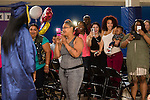 WATERBURY, CT- 8 June 2016-060816EC03-  Smiling faces from the audience greet Emoni Sunday as she walks down the aisle to get her diploma from The State Street School in Waterbury. Five seniors received their diplomas inside the Police Activity League building. Erin Covey Republican-American