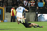 Conrad Smith put a tackle on Marcelo Bosch,   during the 2013 Rugby Championship - All Blacks v Argentina at Waikato Stadium, Hamilton, New Zealand on Saturday, 7th September   2013. Copyright Dion Mellow Photography. Credit DMP / Dion Mellow